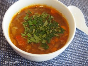Delicious topped with parsley, a bowl of lamb barley soup