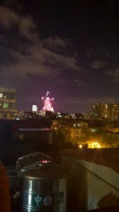 Watching the fireworks from a rooftop. A bit rickety, but lots of fun.